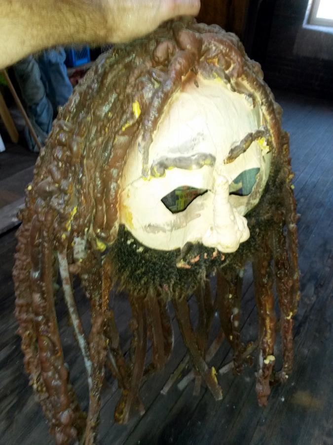 hollow paper mache mask with spray-foam hair